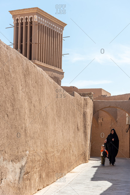 March 5, 2019: Street scene and view of a great windtower (badgir). Yazd, Iran