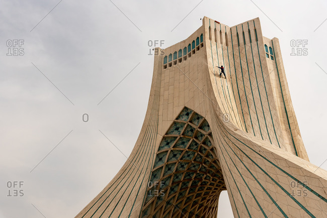 March 11, 2019: View of a man cleaning the Azadi Tower. Tehran, Iran
