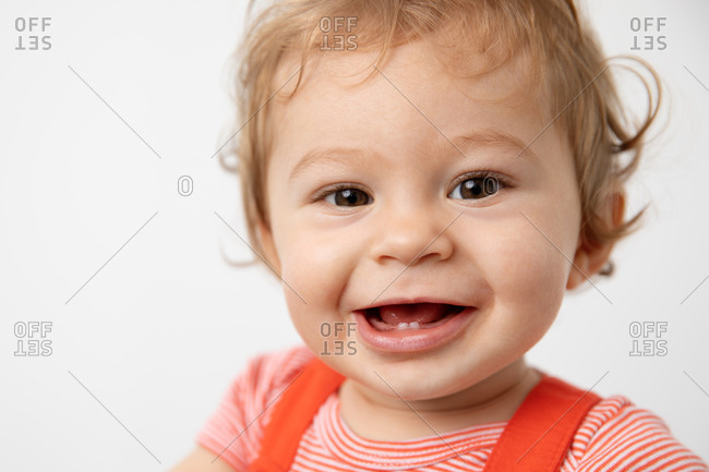 Close up portrait of smiling one year old baby
