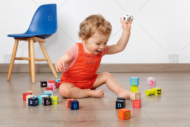 Happy baby building tower with blocks