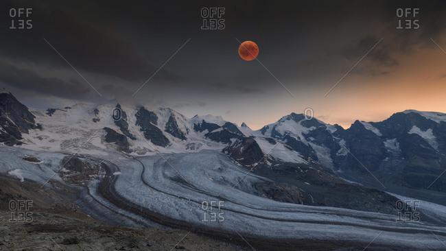 Panoramic view of the Bernina Group with blood moon, Piz Pal¸, Bellavista, Crast Ag¸zza, Piz Bernina, Piz Morteratsch, Pers Glacier, Morteratsch Glacier, Diavolezza, Eastern Alps, Engadin, Switzerland, Europe