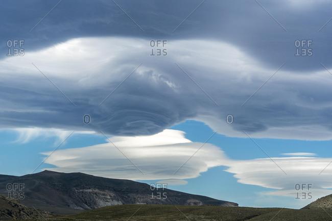 Lenticularis clouds over the mountains at Lago Viedma, Los Glaciares National Park, Santa Cruz Province, Patagonia, Argentina, South America