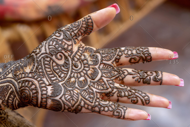 Mehendi tatooed hand of Indian bride on her wedding eve, Mauritius, Africa
