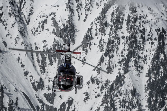 March 5, 2020: Helicopter in front of snow-covered rock face, Himalaya, Gulmarg, Kashmir, India, Asia