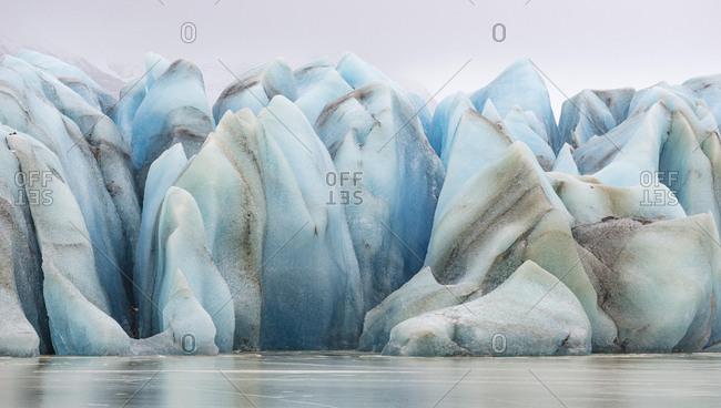 Blue ice, glacial lake HeinabergslÛn, Hˆfn, Austurland, Iceland, Europe