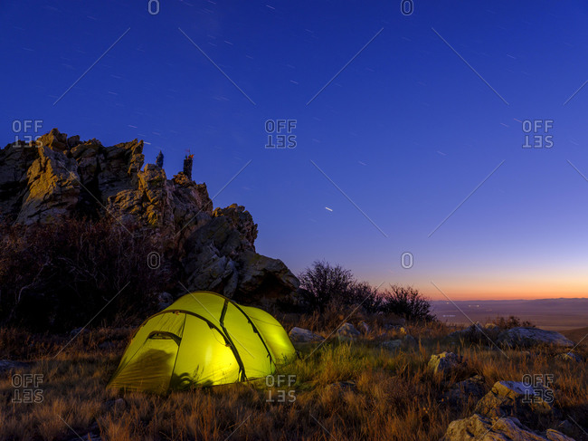Tent under a rock at dusk, Tˆw Aimag, Tˆw province, Mongolia, Asia