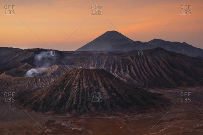 Volcanic pipes with smoking volcano Gunung Bromo, Mt. Batok, Mt. Kursi, Mt. Gunung Semeru, National Park Bromo-Tengger-Semeru, Java, Indonesia, Asia