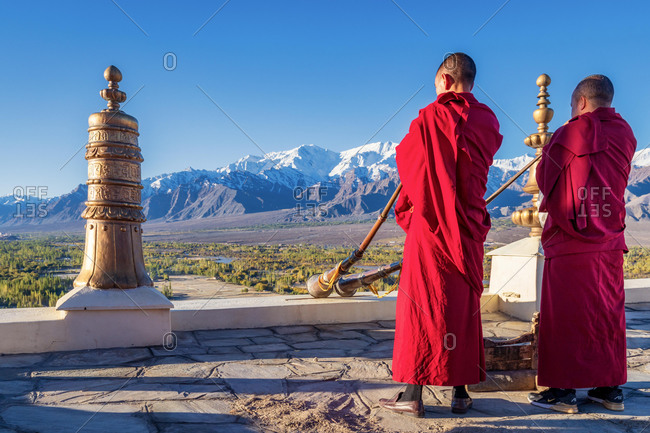 Buddhist monks playing Tibetan horns at Thikse Monastery (Thiksay Gompa), Ladakh, India, Asia