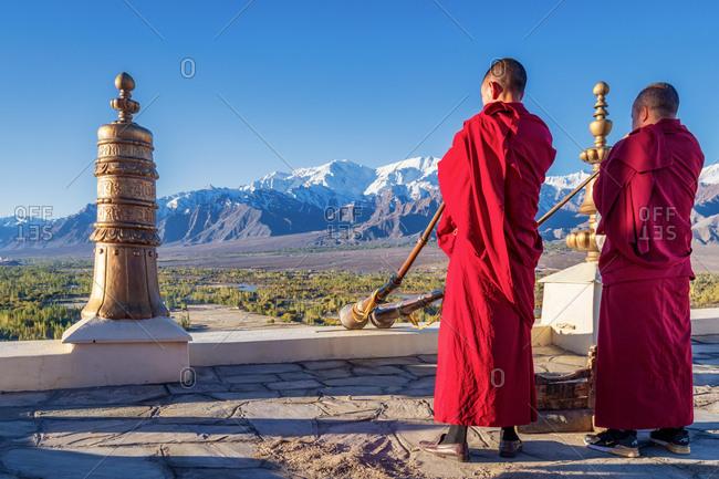 Buddhist monks playing Tibetan horns at Thikse Monastery (Thiksay Gompa), Ladakh, India, Asia