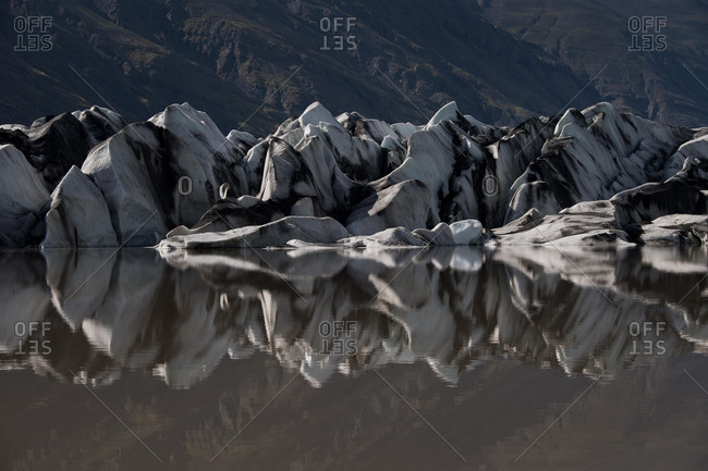 Glacier tongue reflected in the water, glacial lake, Heinabergsjˆkull, Iceland, Europe