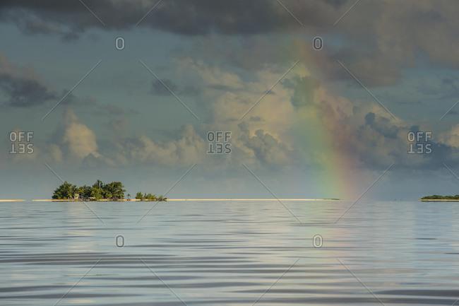Rainbow over the waters of Tikehau, Tuamotus, French Polynesia, Oceania