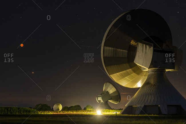 Parabolic antennas with blood moon at lunar eclipse, night shot, Raisting, Upper Bavaria, Germany, Europe
