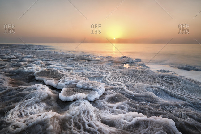 Shore with deposited salt crust, sunset at the Dead Sea, West Bank, Israel, Asia