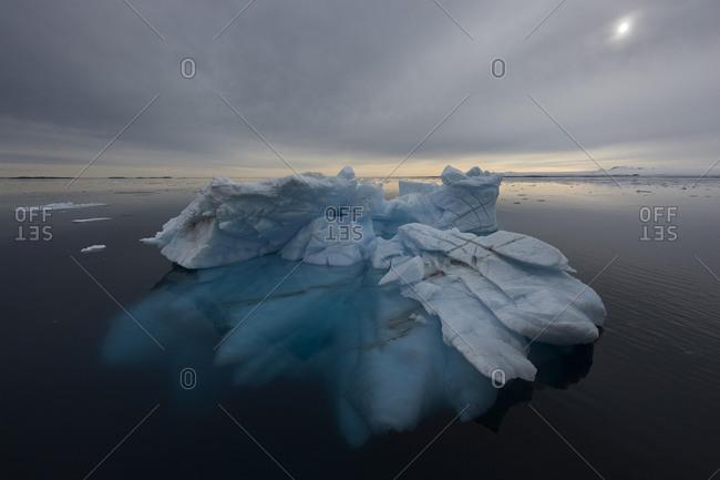 Iceberg with visible ice under water, Hinlopen Strait, Svalbard Archipelago, Norway, Europe