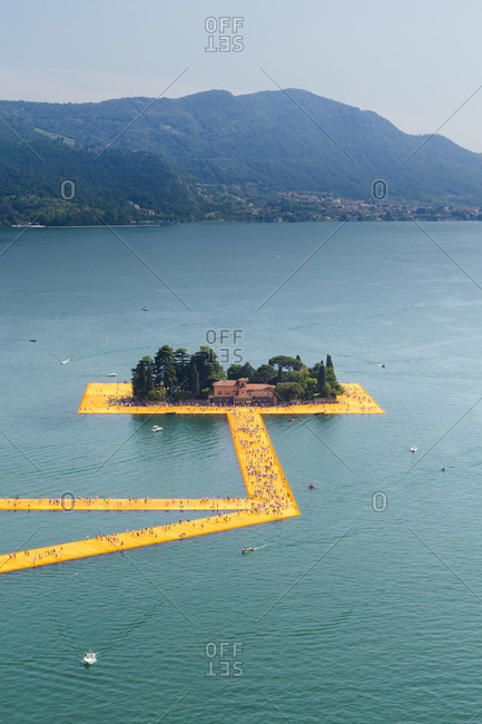 Lake Iseo, Lombardy, Italy - June 22, 2016: Aerial view of The Floating Piers, by Christo and Jeanne-Claude.
