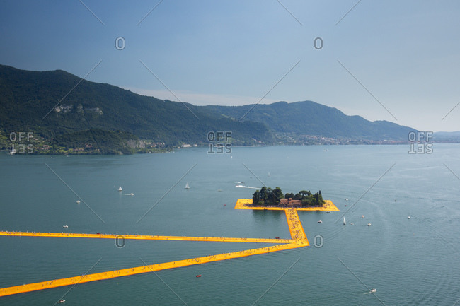 Lake Iseo, Lombardy, Italy - June 22, 2016: The Floating Piers, by Christo and Jeanne-Claude.