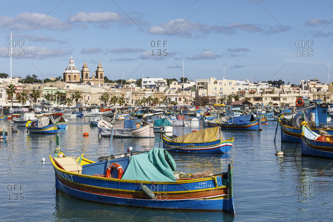 Malta - October 29, 2017: The historic city of Marsaxlokk, famous for its colorful fishing boats called luzzu