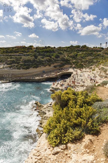 Malta - October 29, 2017: People enjoying summer holiday in St. Peter's Pool