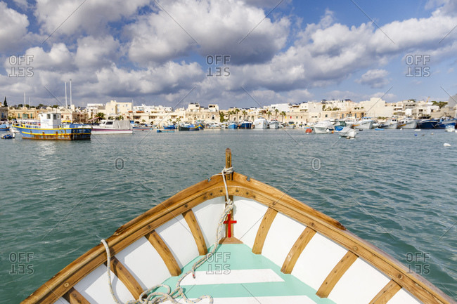 Malta - October 29, 2017: Fishing boats docked in the historic city of Marsaxlokk