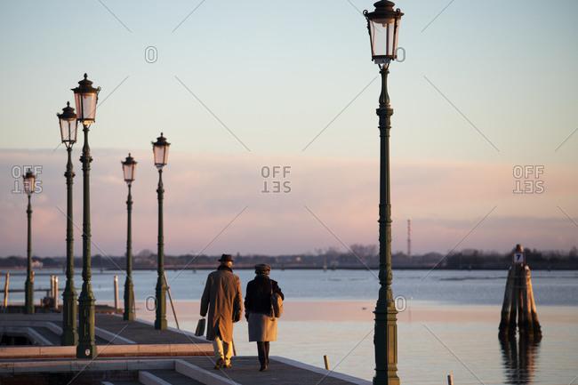 Italy - January 2, 2019: Elderly couple walking in Venice