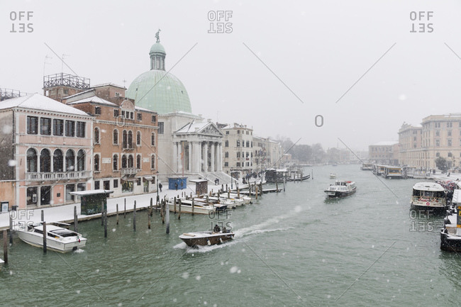 Venice, Italy - March 1, 2018: Venice on a snowy day with San Simeone church and the Grand Canal in the distance