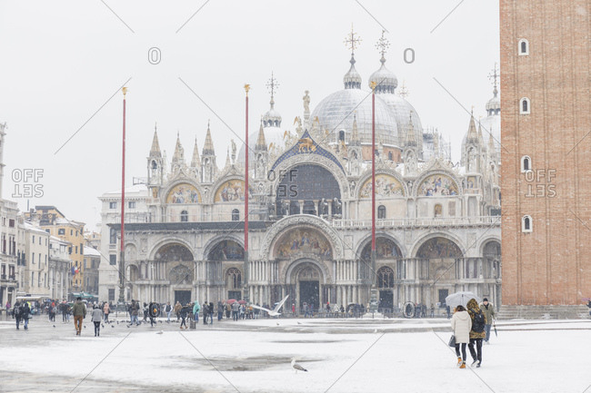 Venice, Italy - March 1, 2018: Tourists on St Mark's square with St Mark's Basilica in the background