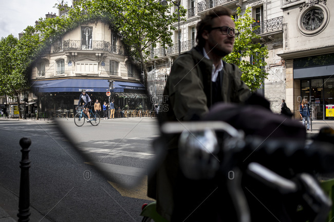 Paris, France - June 11, 2019 : Man riding a bicycle in Paris viewed in mirror