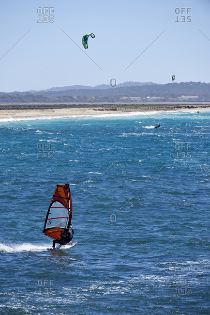 Hyeres, Var, France - April 5, 2018: Windsurfers and kite surfers on famous beach l'Almanarre