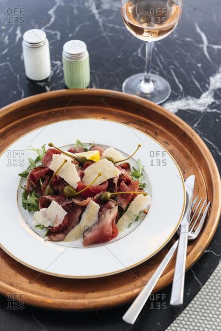 Beef carpaccio with parmigiano and capers