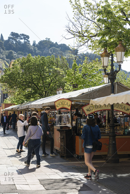 Nice, France - April 17, 2019: Socca and Chez Theresa on Saleya market in Old town Nice