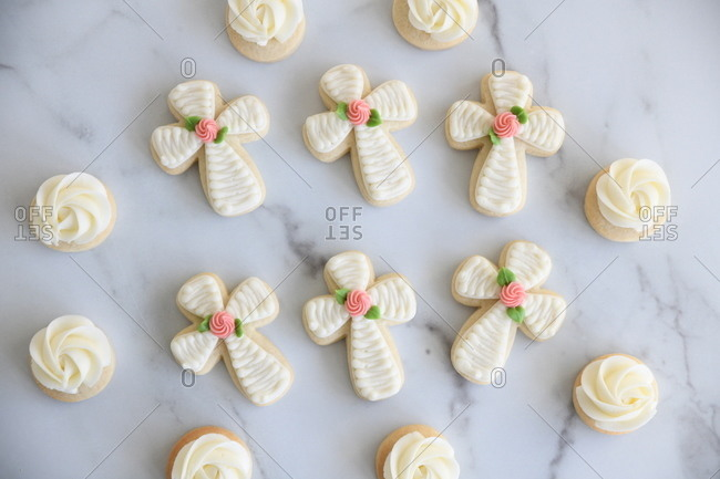 Sugar cookies with icing on marble surface