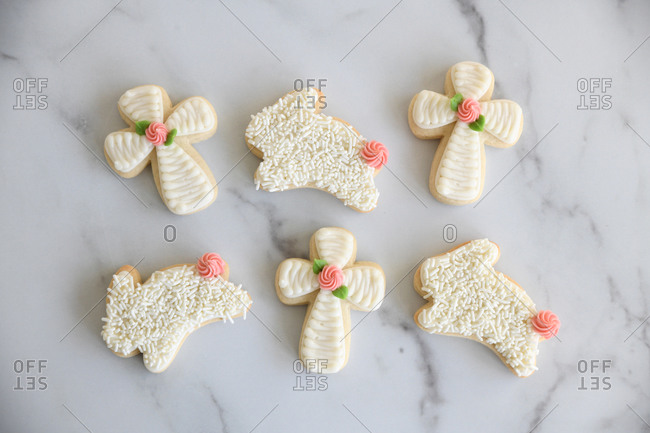 Bunny and cross sugar cookies with icing on marble surface