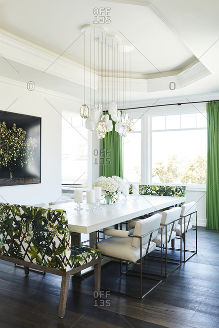 Laguna Beach, California - July 21, 2017: Dining room with large table and green accent colors