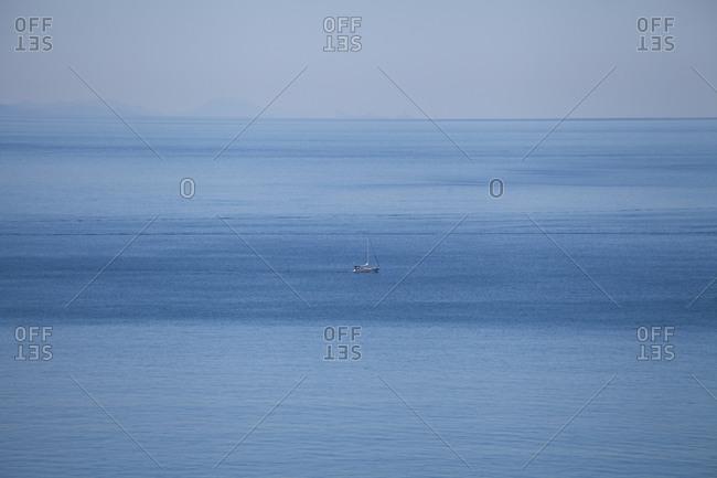 A lone sailboat in the sea