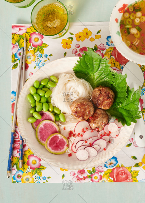 Rice noodles and meatballs with soy beans, watermelon radish and fresh chili