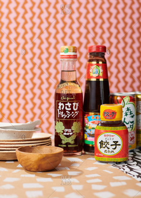 November 23, 2018: Soy sauce, rice wine vinegar and sake bottles against graphic patterned paper backgrounds