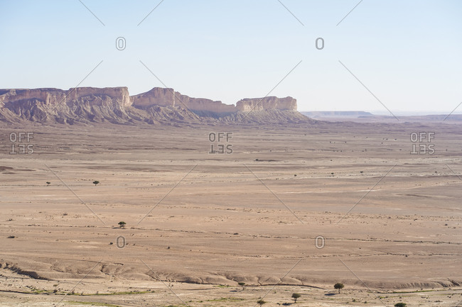 From above picturesque scenery of majestic range of cliffs in desert location in the Edge of the World in Saudi Arabia