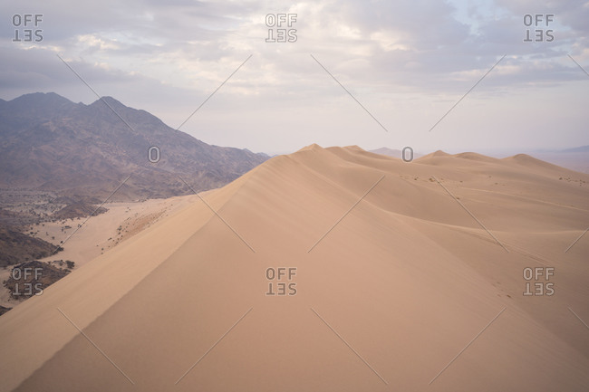 Picturesque scenery of great gritty dunes in endless desert in Saudi Arabia