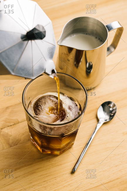 Anonymous barista preparing ice coffee
