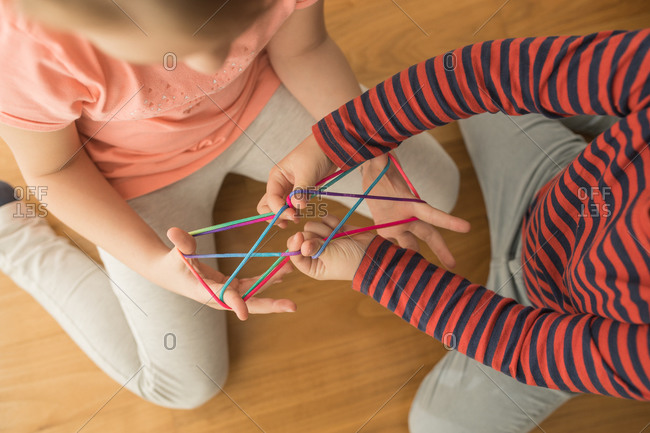 Smart children using rubber bands for game