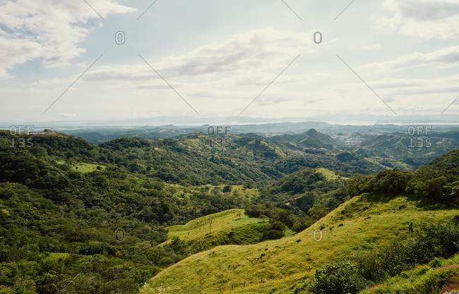 From above scenic landscape of range of green mountains and rain forests in Costa Rica