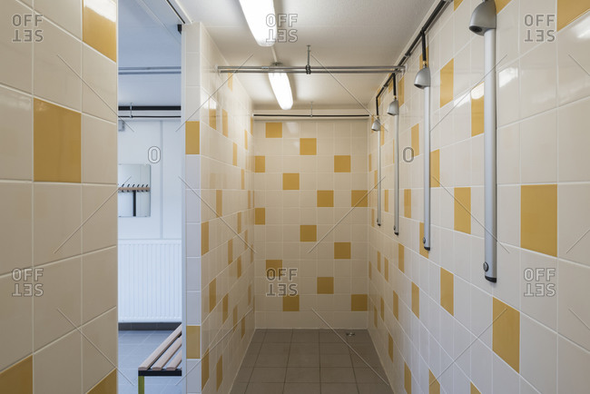 Shower stall with white and yellow tiles