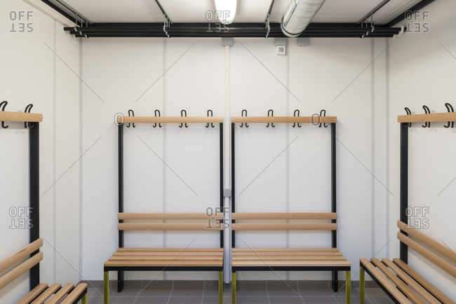 Benches in a changing room in a public bathroom