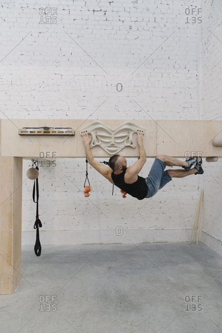 Man doing stretching exercises before climbing