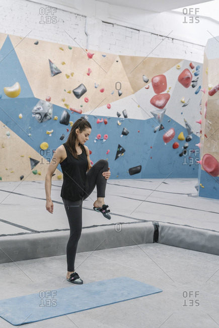 Woman doing stretching exercises before climbing