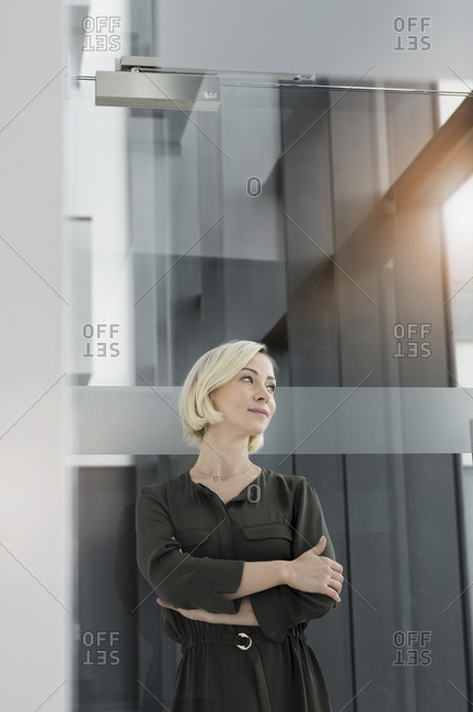 Portrait of blond businesswoman looking at distance