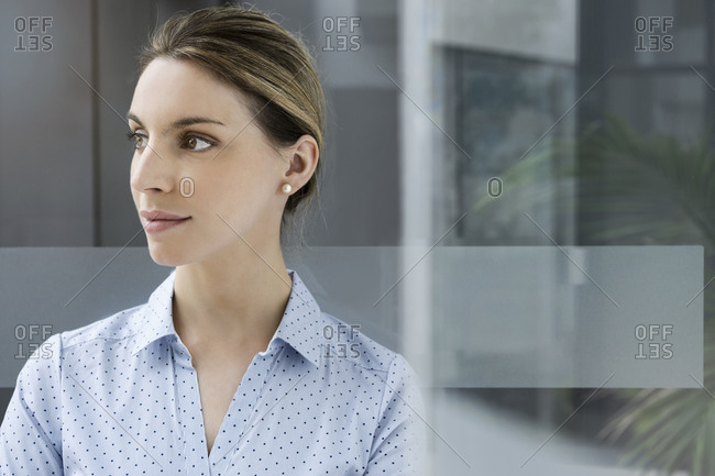 Portrait of a confident young businesswoman in office looking away