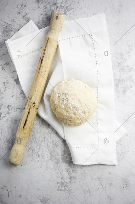 Rolling pin- pizza dough and white napkin