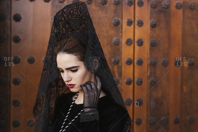 Beautiful woman made up in traditional costume for La Semana Santa