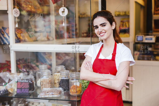 Young woman at the entrance of her bakery